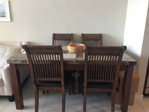 Kitchen table with granite top and four chairs for Sale in Tampa, FL