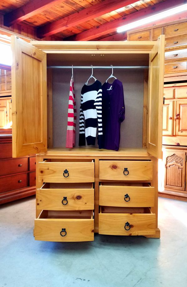 I modified the Armoire with a tube to hang clothes and a new background