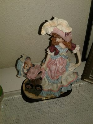Figurine with baby in stroller for Sale in Miami Gardens, FL