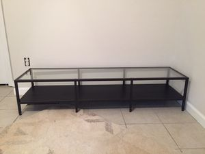 Black metal and glass top tv stand 60 inches long for Sale in Austin, TX