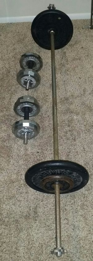 Weights metal 95lbs. 2x25lbs, 6x5lbs, 5x3lbs. 2 chrome dumbbell bars and 6 foot barbell. for Sale in Deerfield Beach, FL