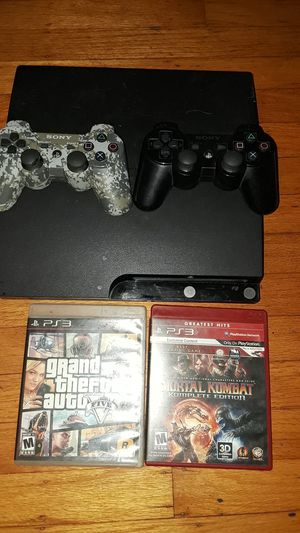 Ps3 slim 2 controllers 2 games for Sale in Vallejo, CA