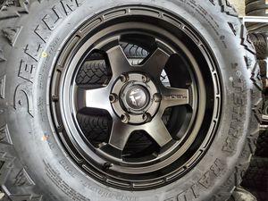 """17"""" Fuel Shok and 33"""" Delium MT 33x12.50 R17 tires for Sale in Orange, CA"""