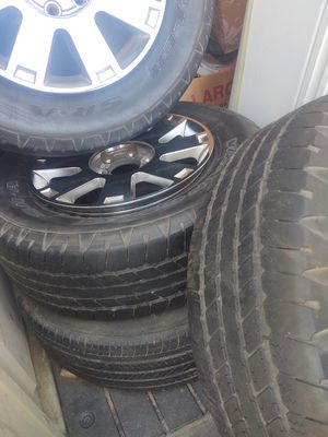 Rims & tires 30% 265/65R18 good cond. except 1 has rust inside loose some air can be fix I have the covers too. ( no sensors or valves)from Lincoln 06 for Sale in Modesto, CA