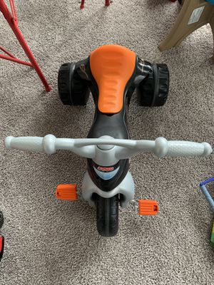McQueen kids table and chair set and Fisher price Ride on bike for Sale in Charlotte, NC