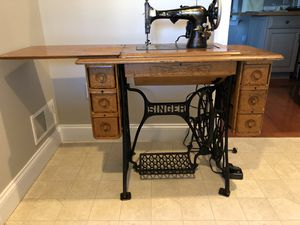 Vintage Singer Sewing Machine and Cabinet for Sale in Harrisburg, PA