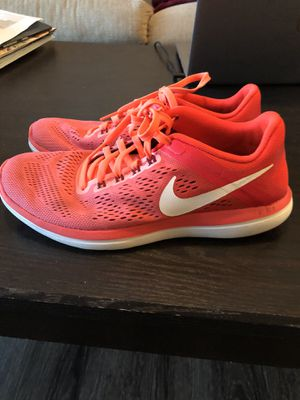 Nike orange tennis shoes size 7 great condition for Sale in Austin, TX