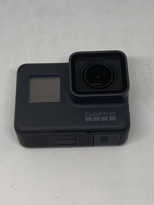 GoPro 5 with oem GoPro charger 2 Batteries and cage for Sale in Katy, TX