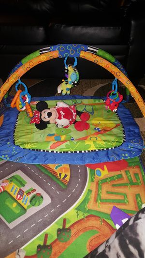 Two Play mats with toys,mickey& racing electronic car. for Sale in Columbus, OH