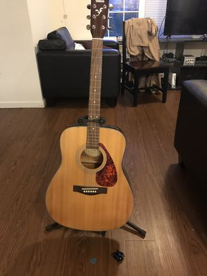 Yamaha acoustic guitar with pick and tuner for Sale in Wichita, KS