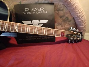 Keith urban signed guitar with case,extra strings,books,cds, for Sale in Perry, KS
