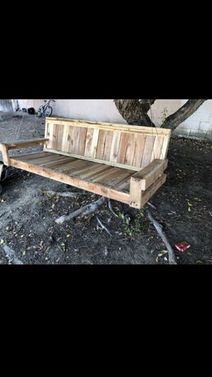 Wood porch swing for Sale in Rancho Cucamonga, CA