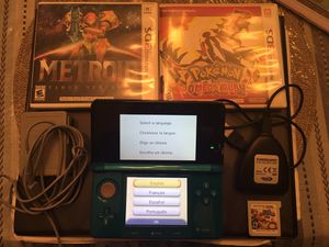 Nintendo 3DS + Super Smash Bros + Pokémon: Omega Ruby + Metroid: Samus Returns + Powersaves for 3DS and charger included for Sale in Woodbridge, VA