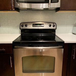 GE stainless steel freestanding range and over the range microwave for Sale in Washington, DC