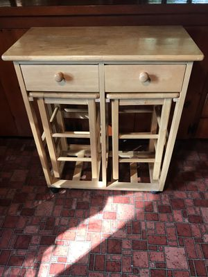WOOD KITCHEN ROLLING FOLDING TABLE ISLAND CART WITH STOOLS. ONE SIDE FOLDS UP TO CREATE SEATING AREA. for Sale in Seattle, WA