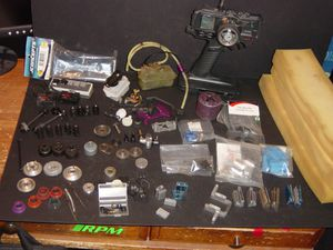 RC car parts lot,traxxas t maxx,unlimited engineering supermaxx titanium center drive,and much more for Sale for sale  East Brunswick, NJ