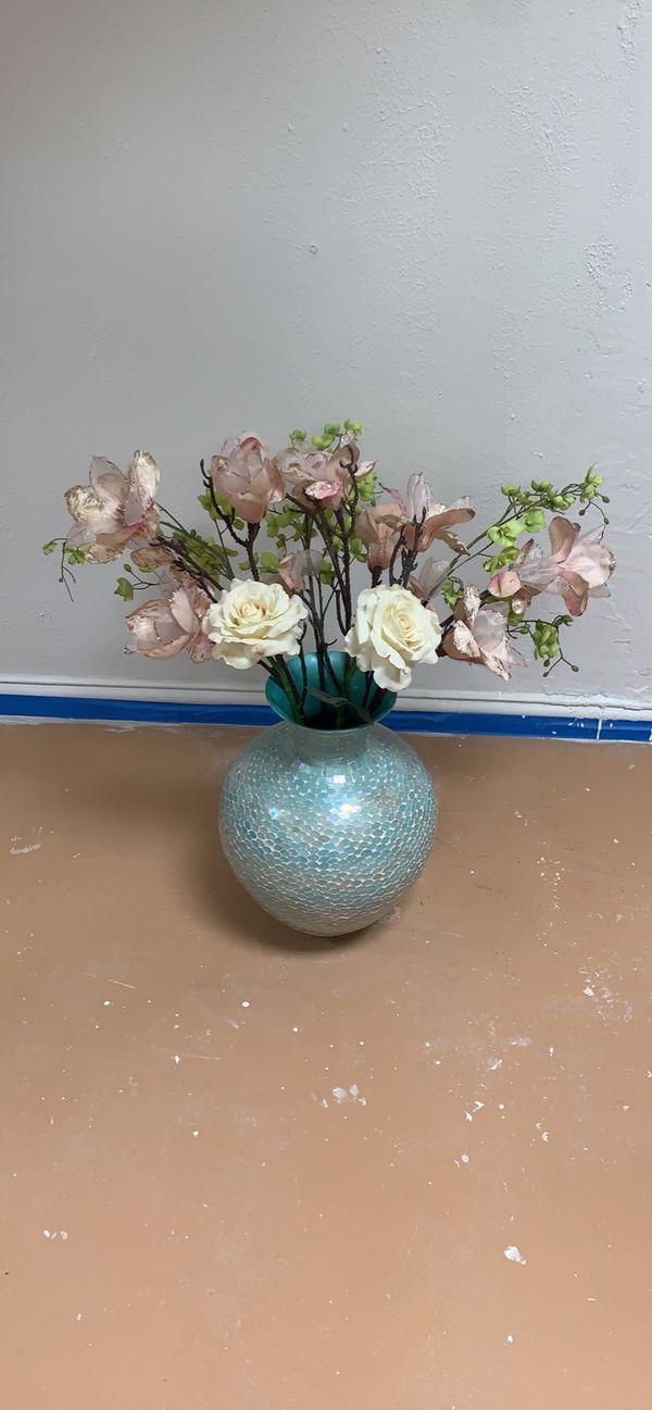 Blue mosaic vase and flowers