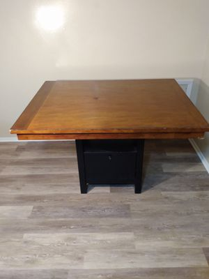 Tall kitchen table that has a storage area at the base for Sale in North Ridgeville, OH