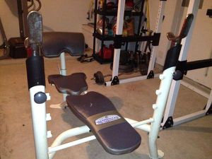 Iron grip strength bench with bench press attachment as well as Olympic bars and 295lbs of Olympic weight for Sale in Annandale, VA