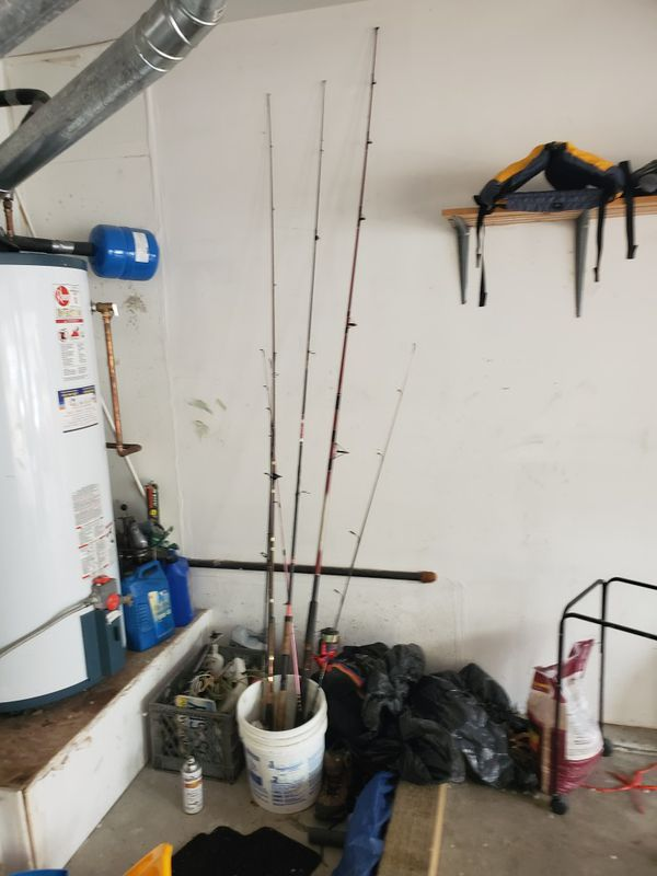 7 fishing poles and reels