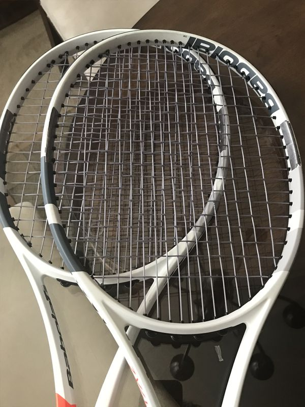 2 Babolat Pure Strike Tennis Rackets + 4 sets of string