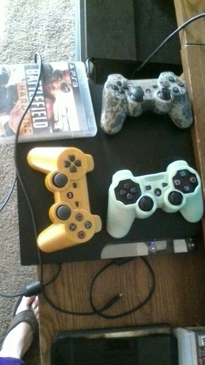 Ps3 2 controllers and a couple of games today only before I change my mind for Sale in Stockton, CA