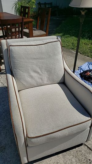 Swivel chair down cushions with braided leather for Sale in Melbourne, FL
