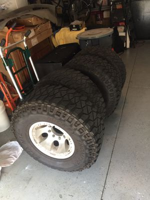 Set of 4 Mickey Thompson 315x75x16 with 8 lug rims ... lug pattern 8x165 for Sale in Oviedo, FL