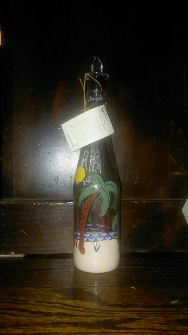 Garden Party of Vermont set of two hand-painted kitchen bottles.
