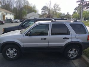 2002 Ford escape & 2005 GMC Yukon XL both great running cars both in good condition very dependable SUVs for Sale in Richmond, VA