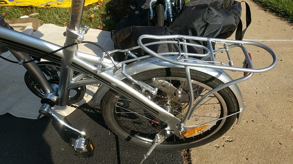 BC fold up bikes with carry bags, 1 silver, 1 black