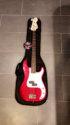 Special red edition P-Bass guitar by Fender with Beginners disk and guitar case. for Sale in Bowie, MD