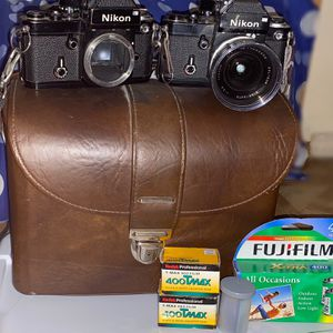 Two Vintage Nikon Cameras With Film And Lens Included. for Sale in Garland, TX