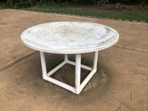 Large white round outdoor patio table, top is very heavy and solid, there is a hole for umbrella if you want, bottom has holes for screw but we never for Sale in Apex, NC