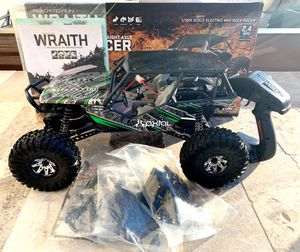 AXIAL WRAITH BRAND NEW NEVER USED WITH BATTERY! 1/10TH SCALE RC ROCK RACER for Sale in Scottsdale, AZ
