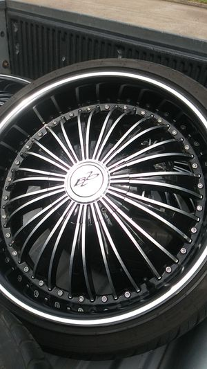 Black Rims off of a Ford Taurus 20 inch have a few little curb sratches have been repainted for Sale in Houston, TX