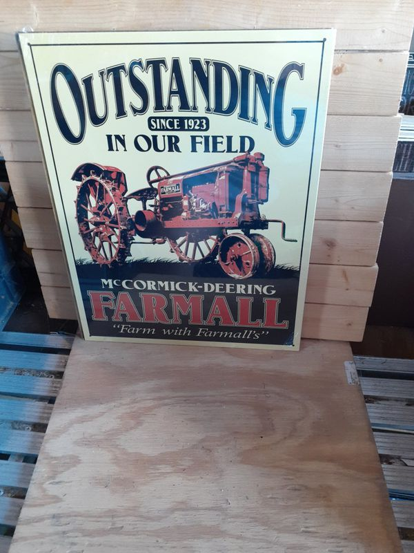 Farmall metal tractor sign 13 by 15 in