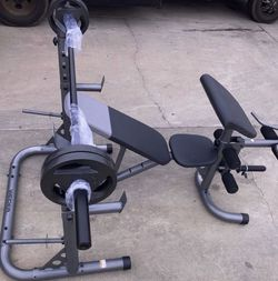 Weights (New In Box )Olympic bench & Olympic rack with 4x25lb 2x10lb Olympic plates and a 3-piece 7ft Olympic bar for Sale in Bellflower,  CA