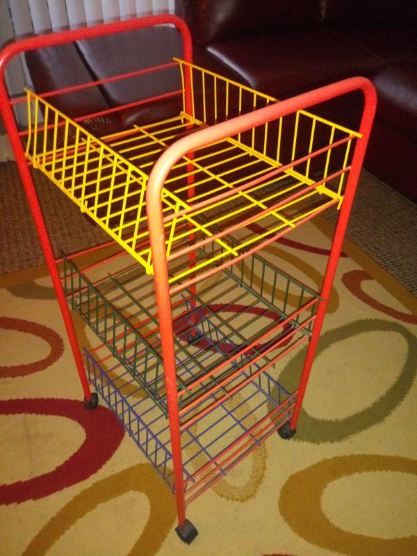 Colorful multi level shelf unit roller