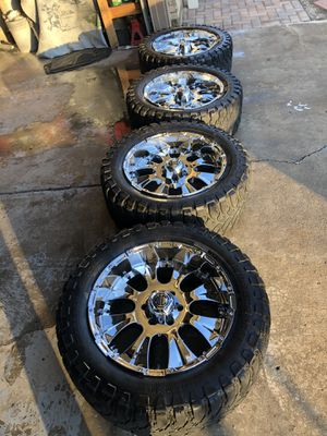 20x10 Chrome rims with 33x12.5x20 tires for Sale in Longmont, CO