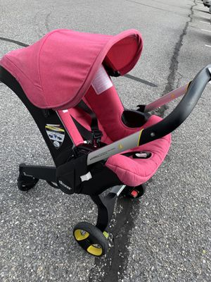 Hot Pink Doona Car Seat Stroller Infant all n one for Sale in Columbia, MD
