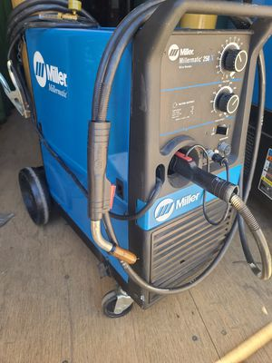 Miller Millermatic 250X mig welder like new, can come with spoolgun and two large tanks for Sale in Riverside, CA