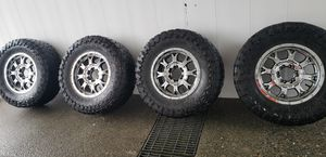 ALL 4 RIMS AND TIRES. AND I WILL DELIVER THEM. for Sale in Everett, WA
