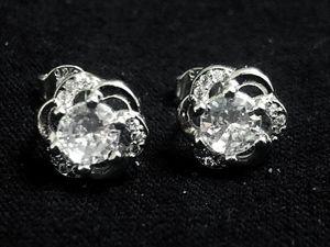 Sterling Silver / CZ on a flower stud earrings for Sale in Las Vegas, NV