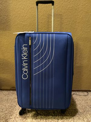 """Calvin Klein luggage 24"""" lightweight 360 spinner for Sale in Ceres, CA"""