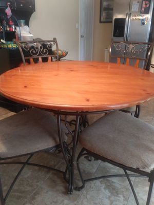 Wrought iron and pine table and chairs for Sale in Smyrna, TN