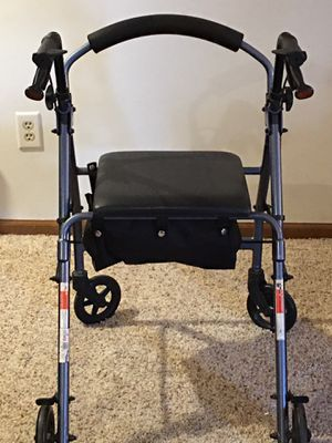 Rolling walker with seat and storage for Sale in Fort Wayne, IN