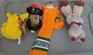 Charizard in pokeball and NEW Pokemon  plushies/socks for Sale in Las Vegas, NV