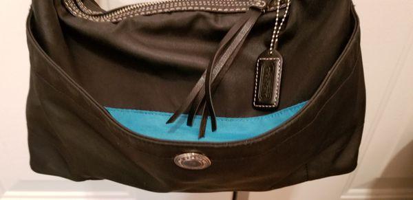 Coach black hobo shoulder bag. Black w Turquoise inside. Used, good condition $15