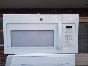 GE white microwave good working conditions for $49 for Sale in Denver, CO